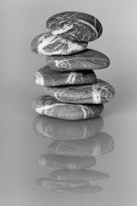 The cairn of balanced stones with reflection